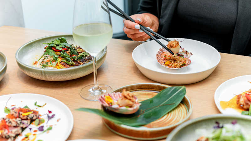 Asian fusion food on a dining table at Botanic House